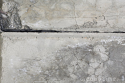 Cement grey wall with crack.