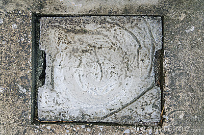 Cement sewer cover of drain in household stock images for Household cement