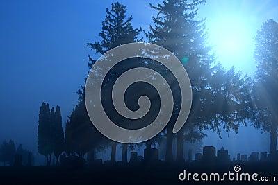 Cemetery in blue fog