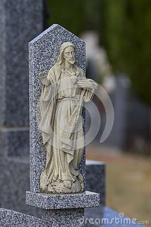 Cemetery detail with stone sculpture