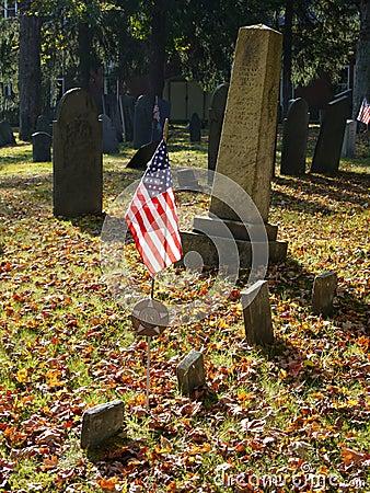 Cemetery: U.S. flag on veterans grave