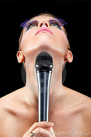 Cemetrical composition of a female singer and mic
