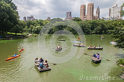 Central Park and Tourists Paddling Editorial Stock Photo