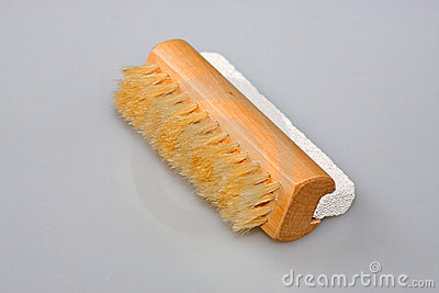 Cepillo del clavo y piedra de piedra pómez