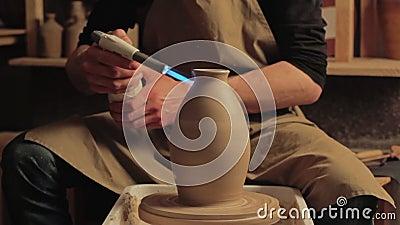 Ceramic art pottery hobby man glazing clay vase. Ceramic art. Pottery hobby. Man hands using propane torch for glazing clay vase at studio stock video