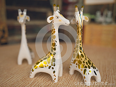 Ceramic giraffe figurine. Depth of field