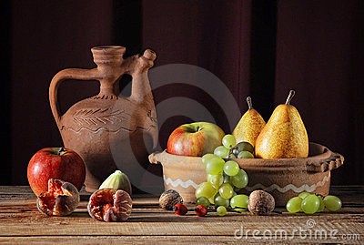 Ceramic jug and fruits