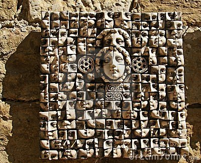 Ceramic panels depicting people s heads