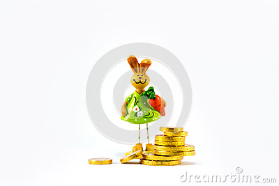 Ceramic rabbit and gold coins.