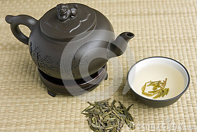 Ceramic teapot with green tea