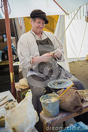 Ceramist (potter) on the medieval market Editorial Photography