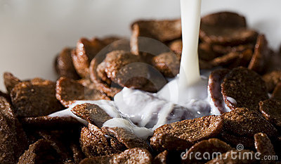 Cereals with pouring milk