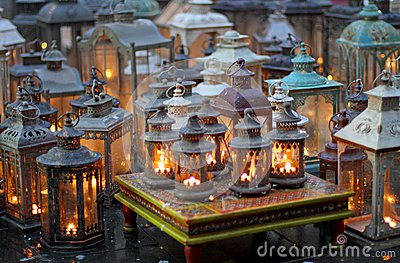Ceremony with many ornaments with lamps lit candles inside
