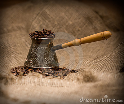 Cezve with freshly roasted coffee beans