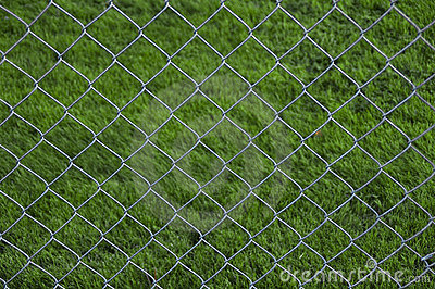 Chain Link Fence With Grass Background Royalty Free Stock Image - Image: 11292606