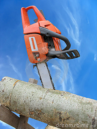 Free Chain Saw In Cut Of Wooden Log Over Blue Sky Stock Photo - 22008610