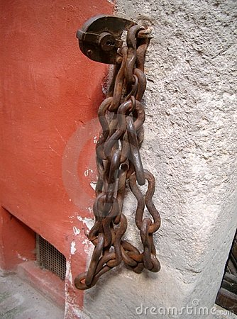 Chain on the wall Stock Photo