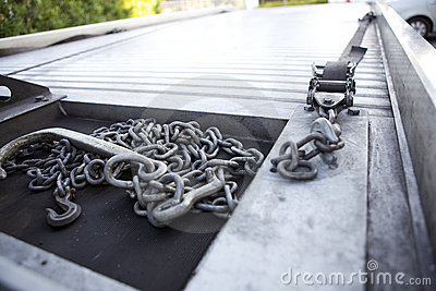 Chains resting on the bed of a tow truck