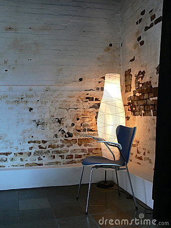 Chair by Brick Wall