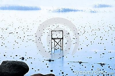Chair on frozen lake