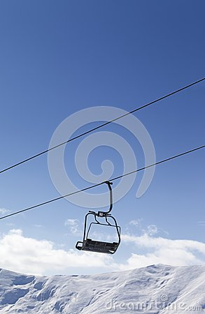 Chair lift against blue sky