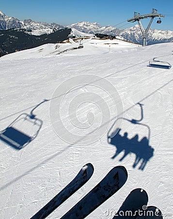 Chair lift shadows on snow