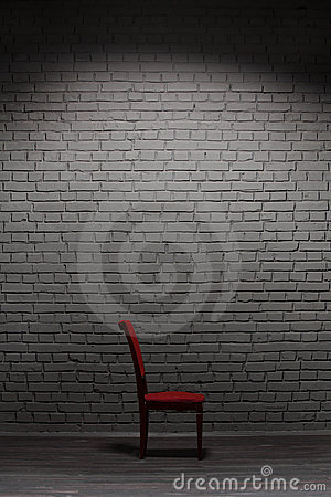 Chair near brick wall