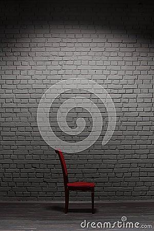 Chair near brick wall