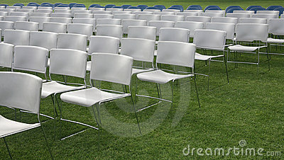 Chair rows and green grass background