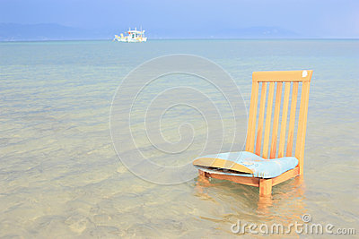 Chair and ship in the distance