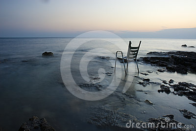 Chair on shore