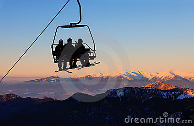 Chair ski lift with skiers