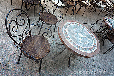 Chair and Table in Street Cafe