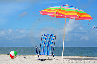 Chair, umbrella and ball at the beach