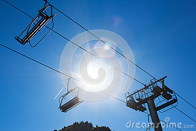 Chairlift against sun