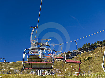 Chairlifts at Alpine ski resort in summer