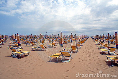 Chairs, beach chairs and umbrellas closed