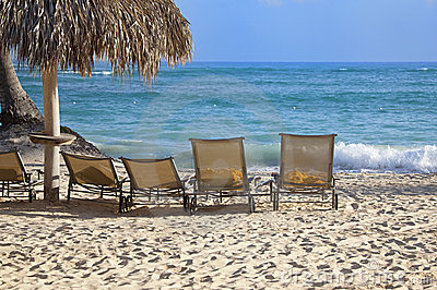 Chairs on beach in front of ocean