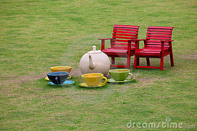Chairs and ceramic tea set in garden