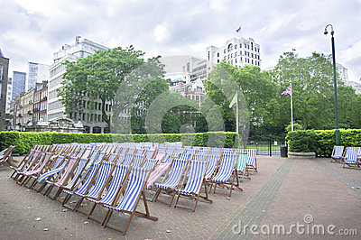 Chairs in city park, London