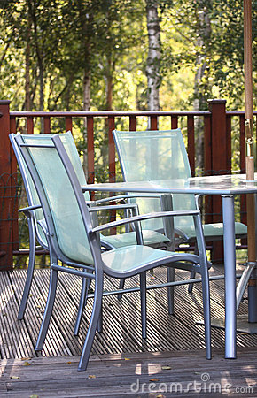 Chairs on decking in summer light