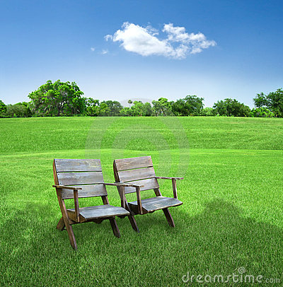 Chairs in field
