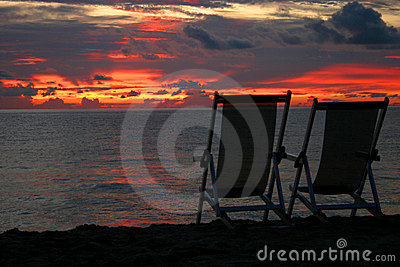 Chairs looking out on beach sunset