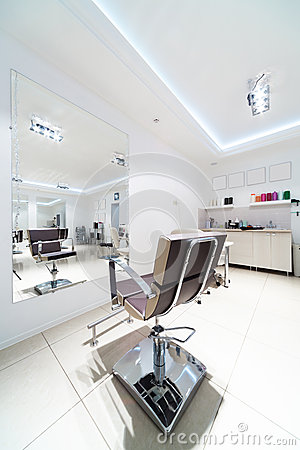 Chairs and mirrors in hairdressing