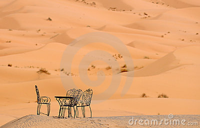 Chairs in sand dunes