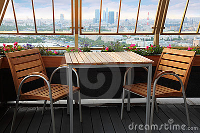 Chairs and table at terrace in restaurant