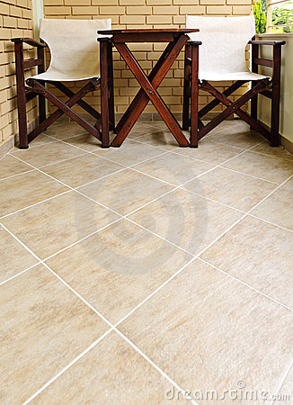 Chairs and table on tiled floor
