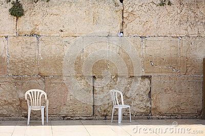 Chairs at a western wall