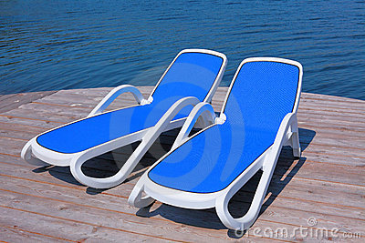 Chaise longues on the deck pier