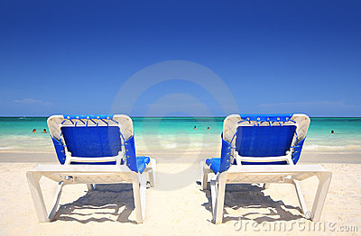 Chaise lounger chairs at beach resort